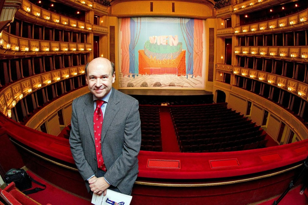 Dominique Meyer, General Director of Vienna State Opera in front of David Hockney's paint scene curtains of the main auditorium of the Opera House